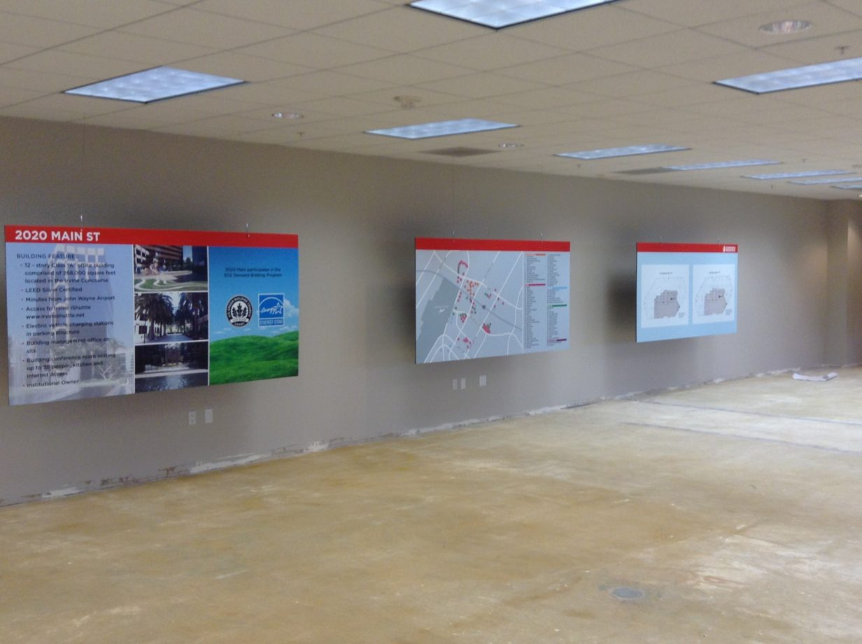 Several informational boards printed on Gator board and hung inside of an empty building for lease.