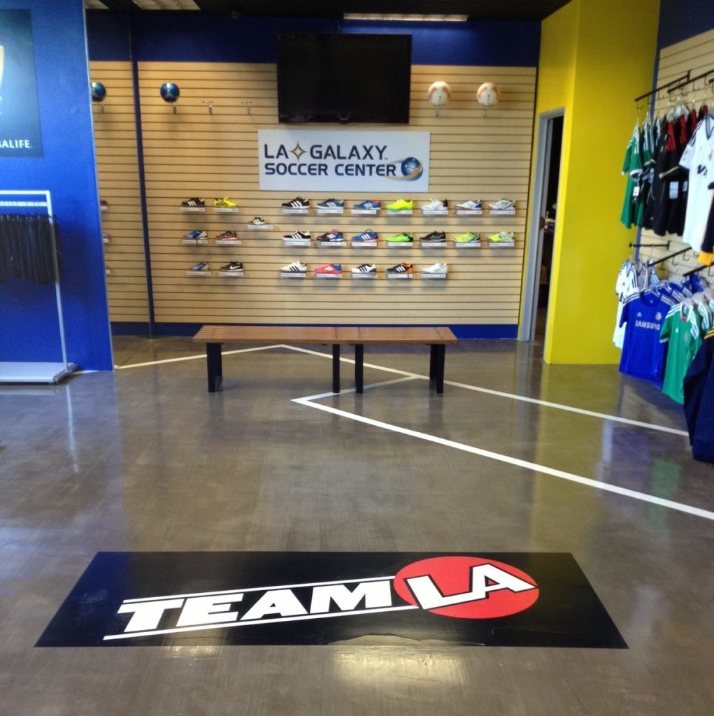 Adhesive vinyl floor graphic in a sports apparel store.