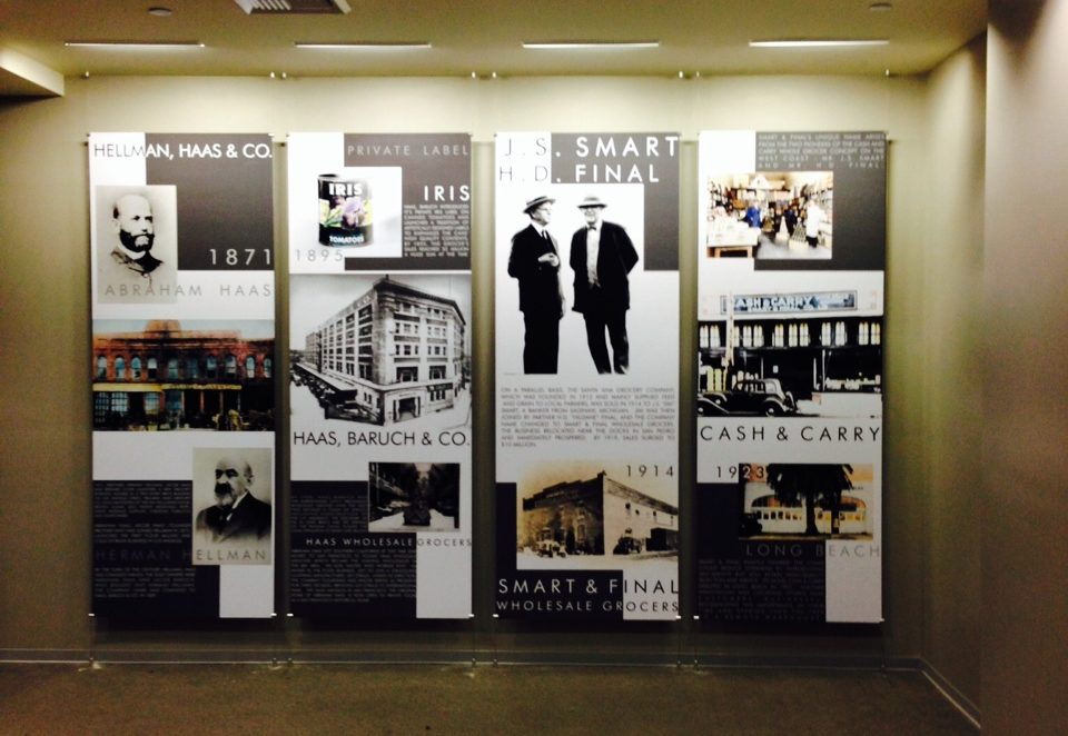 Four boards hung up in a company's lobby which depict milestones from the company's history.